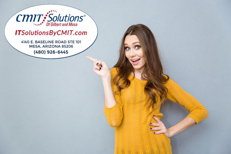 happy woman pointing to the logo of CMIT Solutions of Gilbert and Mesa