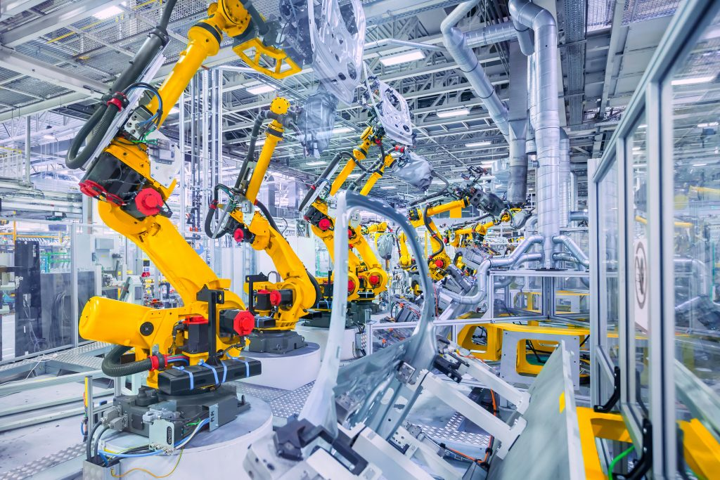 photo of a factory floor featuring bright yellow equipment